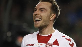 Denmark's Christian Eriksen celebrates after scoring his side's fourth goal during the World Cup qualifying play off second leg soccer match between Ireland and Denmark at the Aviva Stadium in Dublin, Ireland, Tuesday, Nov. 14, 2017. (AP Photo/Peter Morrison)