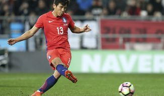 South Korea's Koo Ja-cheol kicks a penalty shot to score against Serbia during a friendly soccer match in Ulsan, South Korea, Tuesday, Nov. 14, 2017. (Kim In-chul/Yonhap via AP)