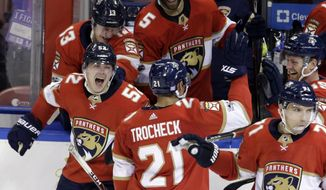 Florida Panthers' MacKenzie Weegar (52) celebrates after Vincent Trocheck (21) scored during the shootout in an NHL hockey game against the Dallas Stars, Tuesday, Nov. 14, 2017, in Sunrise, Fla. The Panthers won 4-3. (AP Photo/Lynne Sladky)