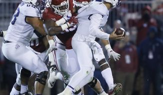 TCU quarterback Kenny Hill (7) is sacked by Oklahoma defensive lineman Kenneth Mann (55) in the second half of an NCAA college football game in Norman, Okla., Saturday, Nov. 11, 2017. Oklahoma won 38-20. (AP Photo/Sue Ogrocki)