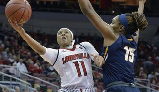 Louisville guard Arica Carter (11) attempts a shot over the defense of Toledo center Kaayla McIntyre (15) during the first half of an NCAA college basketball game, Tuesday, Nov. 14, 2017, in Louisville, Ky. (AP Photo/Timothy D. Easley)