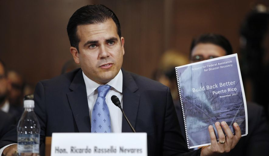 Puerto Rico Gov. Ricardo Rossello went to Capitol Hill to ask for $94 billion to pay for the territory's recovery from Hurricane Maria. Doling out Christmas bonuses to government employees, however, could put that aid in jeopardy. (Associated Press/File)