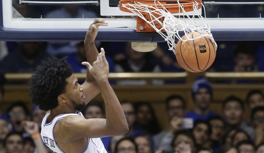 Duke's Marvin Bagley III dunks against Utah Valley during the second half of an NCAA college basketball game in Durham, N.C., Saturday, Nov. 11, 2017. Duke won 99-69. (AP Photo/Gerry Broome)