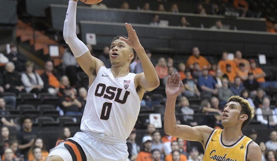 Oregon State's JaQuori McLaughlin drives past Wyoming's Hunter Maldonado during an NCAA college basketball game Monday, Nov. 13, 2017, in Corvallis, Ore. (Andy Cripe/The Corvallis Gazette-Times via AP)