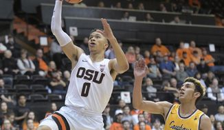 Oregon State's JaQuori McLaughlin drives past Wyoming's Hunter Maldonado during an NCAA college basketball game Monday, Nov. 13, 2017, in Corvallis, Ore. (Andy Cripe/The Corvallis Gazette-Times via AP)
