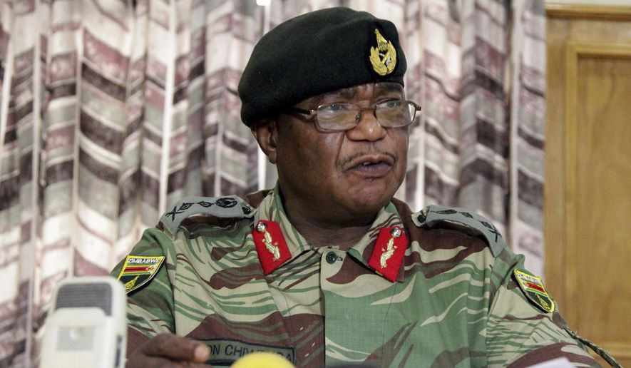 Zimbabwean army commander Constantino Chiwenga Harare held a press conference Monday in Harare, where he threatened to step in to calm political tensions over President Robert Mugabe's firing of his deputy. A day later, armored personnel carriers were seen outside the capital. (Associated Press)