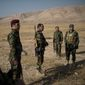 Kurdish leaders remain committed to a political settlement but say their famed peshmerga militia forces are ready to take up arms to defend their homeland. (Associated Press/File)