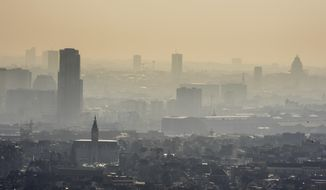 FILE - In this March 14, 2014 file photo a layer of smog covers the city of Brussels. World leaders arrive at the global climate talks in Germany on Wednesday, Nov. 15, 2017 to give the negotiations a boost going into the final stretch. AP Photo/Geert Vanden Wijngaert, file)