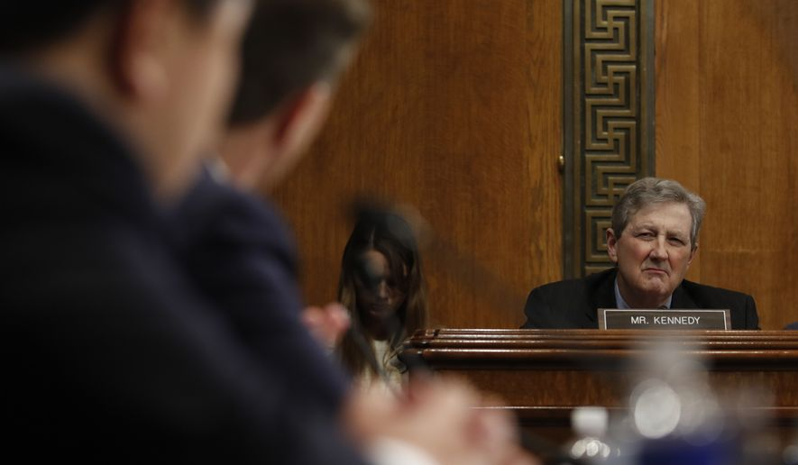 Sen. John Kennedy, R-La., looks to Don Willett, center, and James Ho, left, during a Senate Judiciary Committee hearing on nominations on Capitol Hill in Washington, Wednesday, Nov. 15, 2017. Willett and Ho have been nominated to be United States Circuit Judges For The Fifth Circuit. (AP Photo/Carolyn Kaster)