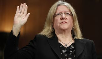 Pamela Bresnahan, Chair, Standing Committee On The Federal Judiciary American Bar Association, is sworn in during a Senate Judiciary Committee hearing on nominations on Capitol Hill in Washington, Wednesday, Nov. 15, 2017. (AP Photo/Carolyn Kaster)