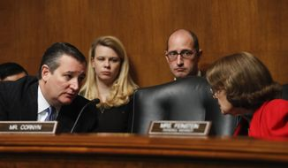Judiciary Committee members, Sen. Ted Cruz, R-Texas, left, talks with racking member Sen. Dianne Feinstein, D-Calif., during a Senate Judiciary Committee hearing on nominations on Capitol Hill in Washington, Wednesday, Nov. 15, 2017. (AP Photo/Carolyn Kaster)