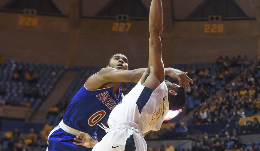 West Virginia's James Bolden is fouled by American's Sa'eed Nelson during the second half of an NCAA college basketball game Wednesday, Nov. 15, 2017, in Morgantown, W.Va. (William Wotring/The Dominion-Post via AP) **FILE**