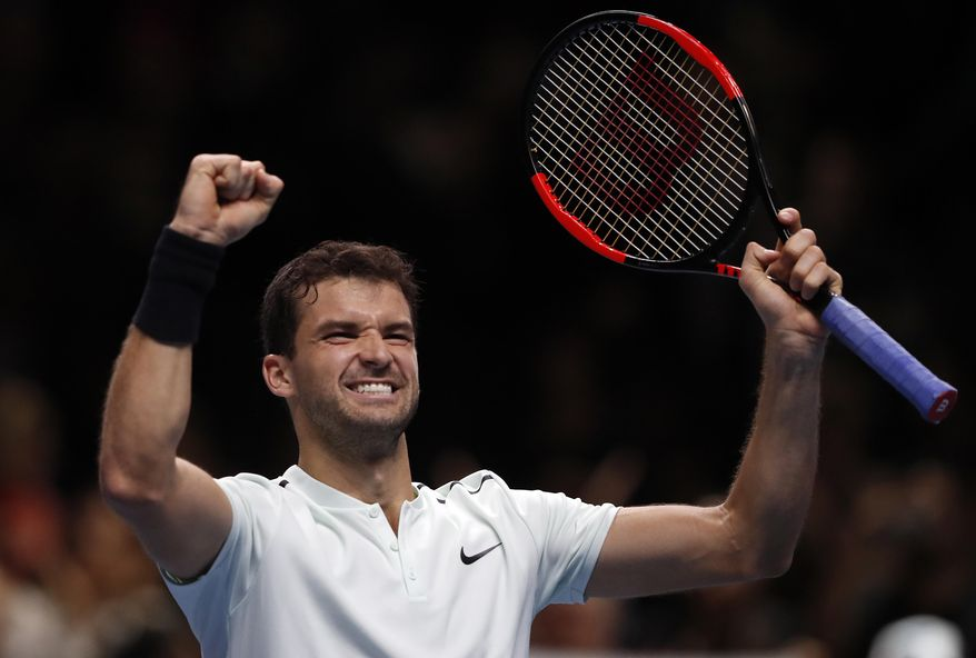 Grigor Dimitrov of Bulgaria celebrates after winning his singles tennis match against David Goffin of Belgium at the ATP World Finals at the O2 Arena in London, Wednesday, Nov. 15, 2017.(AP Photo/Frank Augstein)