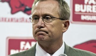 FILE - In this April 10, 2012, file photo, Arkansas athletic director Jeff Long listens to a question during a news conference where he announced that Arkansas football coach Bobby Petrino had been terminated, in Fayetteville, Ark. Arkansas has announced the firing of athletic director Jeff Long, Wednesday, Nov. 15, 2017, after nearly 10 years at the school. (AP Photo/April L. Brown, File)
