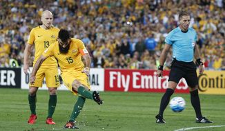 Australia's Mile Jedinak scores a goal against Honduras during their World Cup soccer playoff deciding match in Sydney, Australia, Wednesday, Nov. 15, 2017. (AP Photo/Daniel Munoz)