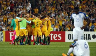 Australian players celebrate after defeating Honduras during their World Cup soccer playoff deciding match in Sydney, Australia, Wednesday, Nov. 15, 2017. (AP Photo/Daniel Munoz)