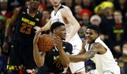 Maryland forward Justin Jackson, center, tries to maintain possession as he is pressured by Butler guard Henry Baddley during the first half of an NCAA college basketball game in College Park, Md., Wednesday, Nov. 15, 2017. (AP Photo/Patrick Semansky) ** FILE **