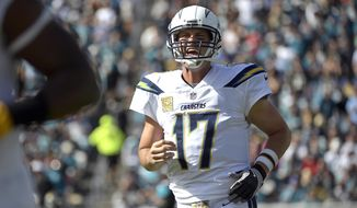 FILE - In this Sunday, Nov. 12, 2017, file photo, Los Angeles Chargers quarterback Philip Rivers shouts to teammates during the first half of an NFL football game against the Jacksonville Jaguars in Jacksonville, Fla. Rivers is in the NFL's concussion protocol after experiencing possible symptoms of a head injury, endangering his streak of 194 consecutive starts since 2006. Rivers told the Chargers about his symptoms Monday after they returned from a 20-17 overtime loss in Jacksonville, coach Anthony Lynn said. (AP Photo/Phelan M. Ebenhack, File)