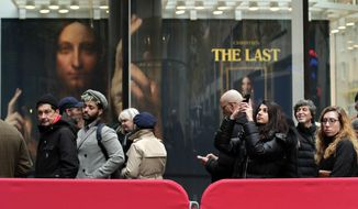 "Visitors to Christie's wait outside in a line to view Leonardo da Vinci's ""Salvator Mundi"", Tuesday, Nov. 14, 2017, in New York. The painting is expected to sell at auction for $100 million on Wednesday. (AP Photo/Julie Jacobson)"