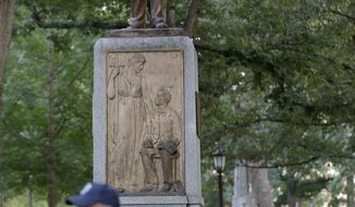 """FILE - In this Aug. 22, 2017, file photo, police stand by a Confederate monument nicknamed """"Silent Sam"""" at the University of North Carolina in Chapel Hill, N.C. The university's board heard from more than 30 speakers who oppose the campus Confederate monument, Wednesday, Nov. 15,  at a comment session during its bimonthly meeting. The statue of an anonymous rebel known as """"Silent Sam"""" has been the site of demonstrations during a nationwide debate on Confederate monuments.  (AP Photo/Gerry Broome, File)"""
