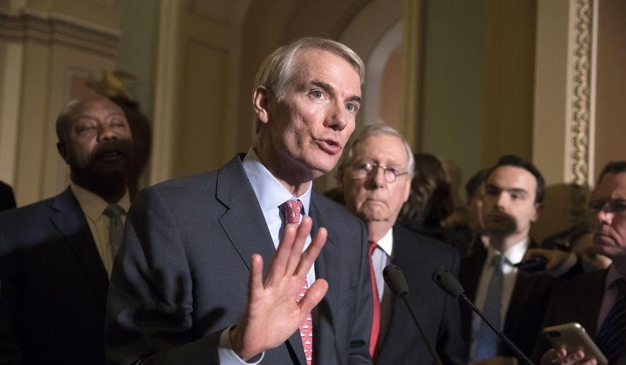 Sen. Rob Portman, R-Ohio, a member of the Senate Finance Committee, joins Sen. Tim Scott, R-S.C., left, and Majority Leader Mitch McConnell, R-Ky., to talk about work on overhauling the nation's tax code, on Capitol Hill in Washington, Tuesday, Nov. 14, 2017. (AP Photo/J. Scott Applewhite) ** FILE **