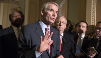 Sen. Rob Portman, R-Ohio, a member of the Senate Finance Committee, joins Sen. Tim Scott, R-S.C., left, and Majority Leader Mitch McConnell, R-Ky., to talk about work on overhauling the nation's tax code, on Capitol Hill in Washington, Tuesday, Nov. 14, 2017. (AP Photo/J. Scott Applewhite)