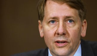FILE - In this Nov. 12, 2013, file photo, Consumer Financial Protection Bureau Director Richard Cordray testifies before a Senate Committee on Banking hearing on Capitol Hill in Washington. Cordray has announced plans to resign his office by the end of November 2017. He is expected to return to his home state of Ohio to run for governor. The Democrat has been a leading critic of President Donald Trump within the government. (AP Photo/Jacquelyn Martin, File)