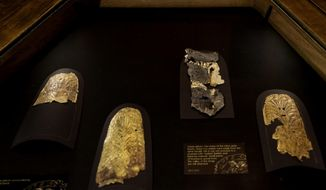 Ancient Egyptian gold artefacts, some restored and some left with small pieces of limestone gravel from the Valley of the Kings still attached, displayed in a glass case during the opening of the exhibition entitled Tutankhamun's Unseen Treasures marking the 115th anniversary of the Egyptian museum in Cairo, Egypt, Wednesday, Nov. 15, 2017.  Egypt has displayed for the first time some previously unseen artefacts of the Pharaoh, famous for his tomb full of golden treasures. (AP Photo/Nariman El-Mofty)