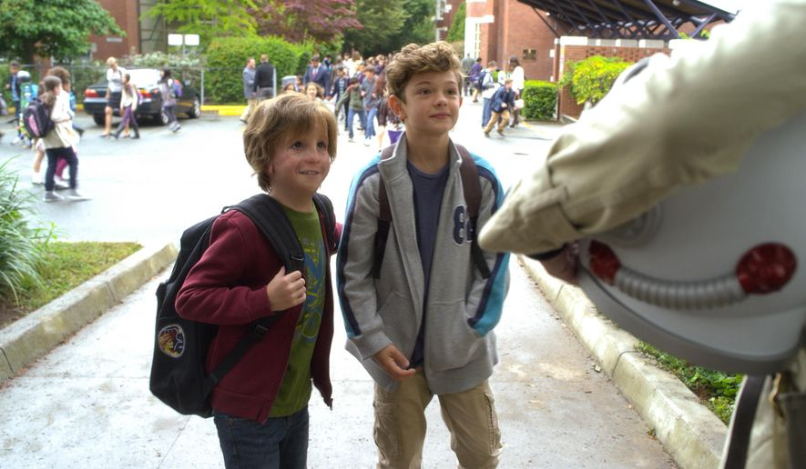 "Jacob Tremblay (left) and Noah Jupe star in ""Wonder."" The box-office success connects with tweens and a demographic rarely targeted by the film industry: mothers. (Associated Press)"