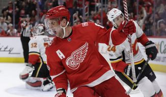 Detroit Red Wings left wing Justin Abdelkader (8) reacts after his goal during the second period of an NHL hockey game against the Calgary Flames, Wednesday, Nov. 15, 2017, in Detroit. (AP Photo/Carlos Osorio)