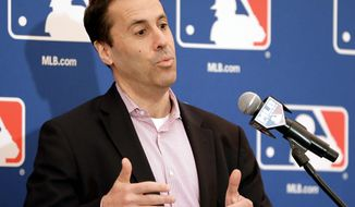 Dan Halem, chief legal officer of Major League Baseball, answers questions during a news conference at the annual MLB baseball general managers' meetings, Wednesday, Nov. 15, 2017, in Orlando, Fla. (AP Photo/John Raoux)