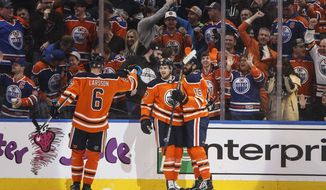 Edmonton Oilers' Adam Larsson (6), Oscar Klefbom (77) and Jujhar Khaira (16) celebrate a goal against the Vegas Golden Knights during the first period of an NHL hockey game Tuesday, Nov. 14, 2017, in Edmonton, Alberta. (Jason Franson/The Canadian Press via AP)