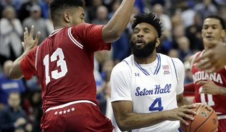 Seton Hall guard Eron Gordon (4) tires to go for a shot against Indiana forward Juwan Morgan (13) during the second half of an NCAA college basketball game, Wednesday, Nov. 15, 2017, in Newark, N.J. Seton Hall won 84-68. (AP Photo/Julio Cortez)