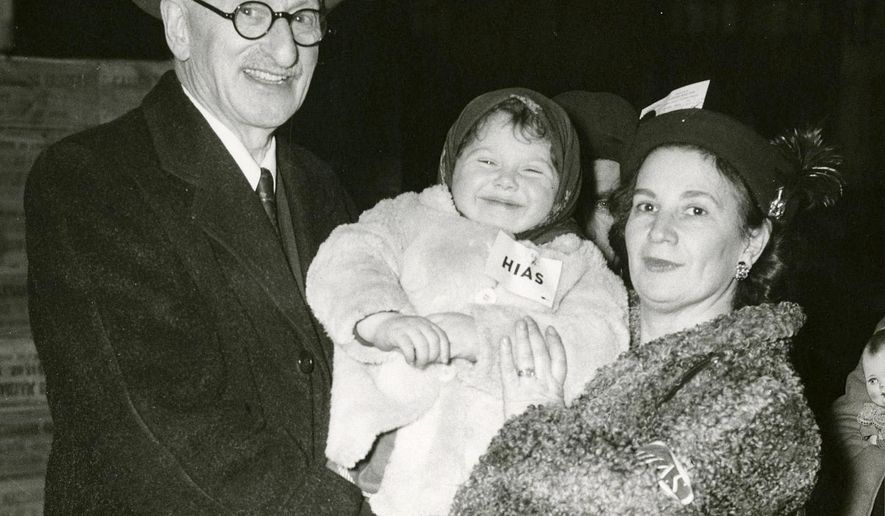 This circa 1940s photo provided by the Jewish Heritage Center at New England Historic Genealogical Society shows Hebrew Immigrant Aid Society representatives Samuel Kalesky and Helen Alpert with a young child. The society is celebrating the launch on Wednesday, Nov. 15, 2017, of its new Jewish Heritage Center containing about 1.2 million documents that includes the records of the area's Jewish philanthropies, publications, synagogues, and even the personal papers of some of the region's prominent Jewish citizens. (Jewish Heritage Center at New England Historic Genealogical Society via AP)