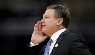 Kansas coach Bill Self shouts to his team during the first half of an NCAA college basketball game against Kentucky on Tuesday, Nov. 14, 2017, in Chicago. (AP Photo/Paul Beaty)