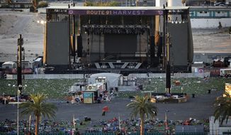FILE - In this Tuesday, Oct. 3, 2017, file photo, debris litters a concert festival grounds after a mass shooting in Las Vegas. Legal action stemming from the mass shooting at the concert is picking up with lawsuits filed Wednesday, Nov. 15, on behalf of 14 concertgoers. (AP Photo/John Locher, File)