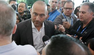 Derek Jeter, chief executive officer and part owner of the Miami Marlins, talks with members of the media at the annual MLB baseball general managers' meetings, Wednesday, Nov. 15, 2017, in Orlando, Fla. (AP Photo/John Raoux)