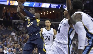 Indiana Pacers guard Darren Collison (2) shoots ahead of Memphis Grizzlies forward Dillon Brooks (24), guard Mario Chalmers (6), and forward JaMychal Green, far right, in the first half of an NBA basketball game Wednesday, Nov. 15, 2017, in Memphis, Tenn. (AP Photo/Brandon Dill)