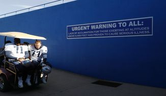 New England Patriots offensive tackles Cameron Fleming, left, and Nate Solder ride on a golf cart to a waiting bus on the ramp leading out of Falcon Stadium as the Patriots head to a nearby field for practice Wednesday, Nov. 15, 2017, on the campus of the Air Force Academy in Air Force Academy, Colo. The Patriots are practicing at Air Force, which is located at an elevation of 7,200 feet, to prepare to face the Oakland Raiders during an NFL football game Sunday in Mexico City, which sits at an elevation of almost 7,400 feet above sea level. (AP Photo/David Zalubowski)