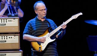 FILE - In this July 4, 2009 file photo, Walter Becker, of U.S. rock group Steely Dan, performs in the Stravinski Hall stage at the 43nd Montreux Jazz Festival, in Montreux, Switzerland. The wife of the Walter Becker says the Steely Dan guitarist died while being treated for esophageal cancer. Becker died at age 67 in September, but no details about the death were revealed at the time. (AP Photo/Keystone, Jean-Christophe Bott, File)