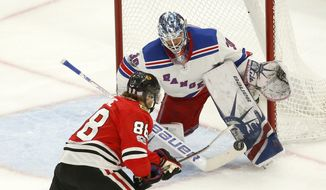 New York Rangers goalie Henrik Lundqvist (30) makes a point-blank save on a shot by Chicago Blackhawks' Patrick Kane during the second period of an NHL hockey game, Wednesday, Nov. 15, 2017, in Chicago. (AP Photo/Charles Rex Arbogast)