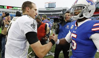 New Orleans Saints quarterback Drew Brees (9) shakes hands with Buffalo Bills quarterback Tyrod Taylor (5) after an NFL football game Sunday, Nov. 12, 2017, in Orchard Park, N.Y. (AP Photo/Jeffrey T. Barnes)