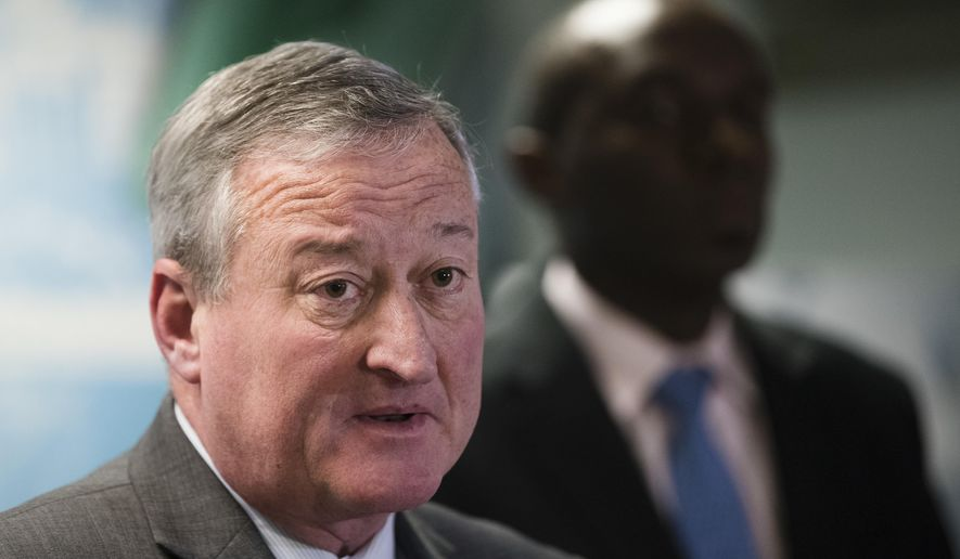 "Philadelphia Mayor Jim Kenney, left, accompanied by City Solicitor Sozi Pedro Tulante, speaks during a news conference in Philadelphia, Wednesday, Nov. 15, 2017. A federal judge on Wednesday blocked the U.S. government from withholding a major grant that pays for public safety equipment because Philadelphia is a ""sanctuary city."" (AP Photo/Matt Rourke)"