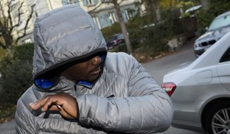 Jamaican sprinter Nesta Carter arrives for a hearing at the Court of Arbitration for Sport (CAS) in Lausanne, Switzerland, Wednesday, Nov 15, 2017 after filing an appeal against the IOC that stripped him of his 2008  Beijing Olympics sprint relay gold medal due to anti-doping rule violations.. (Jean-Christophe Bott/Keystone via AP)