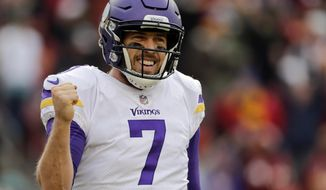 FILE - In this Sunday, Nov. 12, 2017, file photo, Minnesota Vikings quarterback Case Keenum (7) celebrates wide receiver Jarius Wright's touchdown during the second half of an NFL football game against the Washington Redskins in Landover, Md.  Keenum is coming off a career-high four touchdown passes that helped the Vikings secure a critical win at Washington, but his status as the starter is still on a week-to-week basis with Teddy Bridgewater hovering as the backup. (AP Photo/Mark Tenally, File)