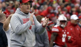 "FILE - In this Saturday, Nov. 11, 2017, file photo, Wisconsin head coach Paul Chryst claps on the sidelines during an NCAA college football game against Iowa in Madison, Wis. Prod Wisconsin players with enough questions about the College Football Playoff and it just might crack their ""next-game-only"" armor. Otherwise, the fifth-ranked Badgers follow the lead of calm, collected coach Paul Chryst, who excels at keeping his players focused.  (AP Photo/Aaron Gash, File)"