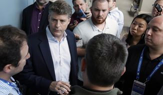 Hal Steinbrenner, second from left, principal owner, managing general partner and co-chairman of the New York Yankees, talks with reporters at the annual MLB baseball general managers' meetings, Wednesday, Nov. 15, 2017, in Orlando, Fla. (AP Photo/John Raoux)