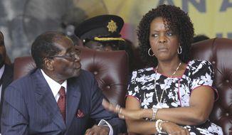 In this Saturday Feb. 27, 2016, file photo, Zimbabwe President Robert Mugabe and his wife Grace attend his birthday celebrations in Masvingo. (AP Photo/Tsvangirayi Mukwazhi, File) ** FILE **