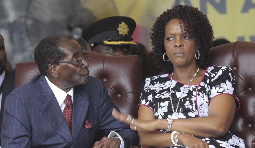 In this Saturday Feb. 27, 2016, file photo, Zimbabwe President Robert Mugabe and his wife Grace attend his birthday celebrations in Masvingo. (AP Photo/Tsvangirayi Mukwazhi, File) ** FILE **