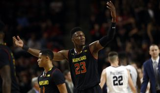 Maryland forward Bruno Fernando, of Angola, winds up the crowd in the second half of an NCAA college basketball game against Butler in College Park, Md., Wednesday, Nov. 15, 2017. (AP Photo/Patrick Semansky) **FILE**